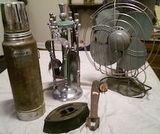 "1950s green/gray Military Desk fan, still works, doesn't oscillate, though; 50s-60s mini/desktop Fireplace tool set with stand, green/gray enamel and silver metal. Includes coal shovel, brush, tongs and poker; Vintage Aladdin Stanley metal thermos, green/gray, includes cup, missing strap: Antique cast iron ""pre electric"" clothes iron and cast iron wood stove lid handle. Will sell individually, price negotiable."