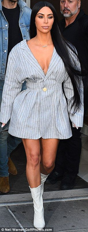 The star's dress was most unusual as it looked like an oversized striped blazer with only ...