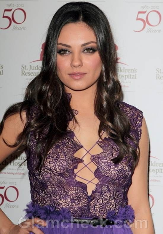 Mila Kunis in purple lace number with a plunging neckline featuring crisscross design