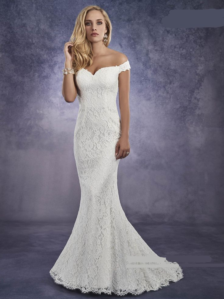 15259 Normans Bridal Gown. Re-embroidered lace bridal gown in fit and flare style with off-the-shoulder neck line, chapel train, and back zipper closure.