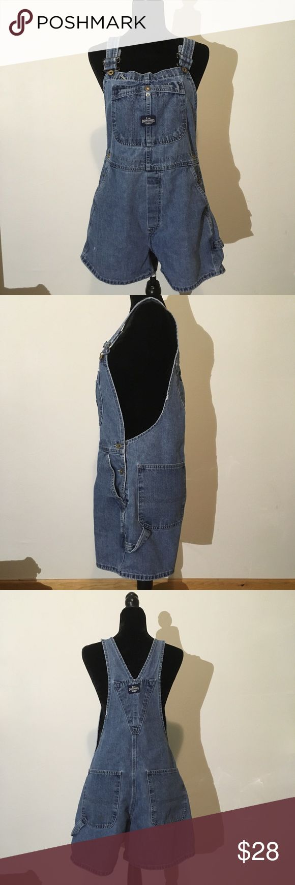"""Lee Dungarees vintage denim overall shorts Lee Dungarees vintage lightly distressed denim overall shorts 🌟Size- Women's L 🌟Flat Measurements- 16"""" waist 34.5"""" from top of shoulder to hem 3"""" inseam 🌟Material- tag is too worn to read, cotton and polyester blend 🌟Condition- Great used condition, lightly distressed. Small discoloration on left back pocket, pictured Lee Dungarees Jeans Overalls"""