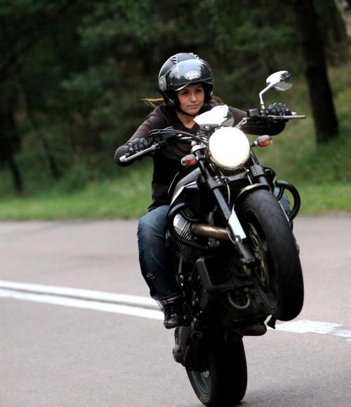 "I just love the look on her face.  ""Yeh, no big deal. Lofting the wheel on a Moto Guzzi; just another day"""