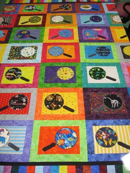 This is an i-spy quilt by Suzy B. for her grandson James (who's 4).  Each little spy glass has a different fabric.  This quilt is hard to appreciate from a picture, but it's really cool to look at all the different things.. This next quilt was made by Maureen.  She's a New Yorker, and decided …