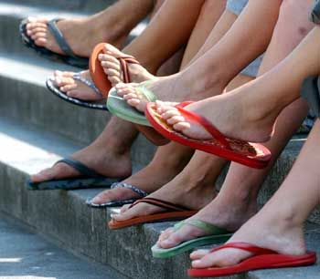Flats, heels, or dressy open-toed shoes are appropriate for the classroom. Save the flip flops for a day at the beach.