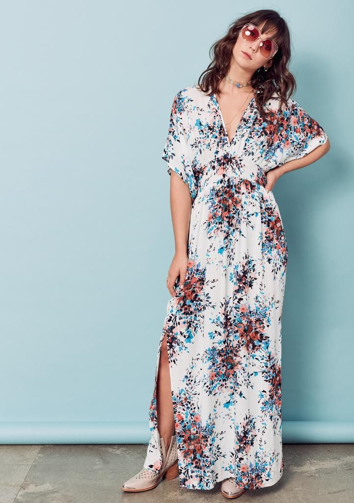 Effortlessly chic, double v-neck, vintage bouquet floral printed maxi dress featuring kimono style sleeves, side slits, smocked waist and tie neck detail. 100% Rayon Model is 5'8, wearing a size S/M.