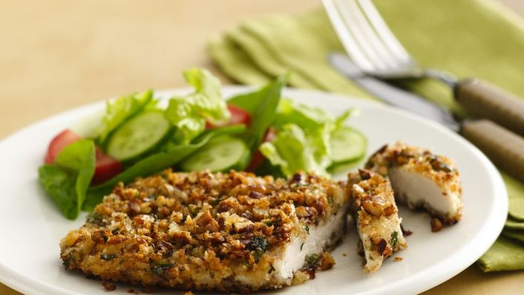 Crispy panko bread crumbs and pecans coat chicken breasts that are first dipped in yogurt--they're cooked until crispy and golden.