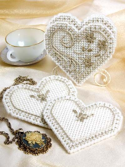 Delight your favorite newlyweds with a coaster set that mimics the beauty of pressed tin. 7-count plastic canvas. Skill Level: Intermediate