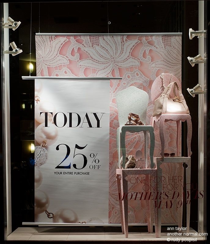 promotional pink and white sale window display