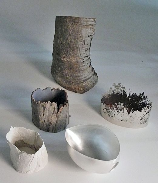 Marian Hosking, Clearing, 2012, containers, saw-pierced and formed sterling silver, molded porcelain, constructed and found eucalyptus and banksia timber, stump: 560 x 500 x 310 mm, baler shell vessel: 170 x 350 x 220 mm, coastal heath land, swamp: 180 x 300 x 185 mm, hollow stump vessel: 200 x 210 x 180 mm, hollow stump: 240 x 240 x 185 mm, photo: artist
