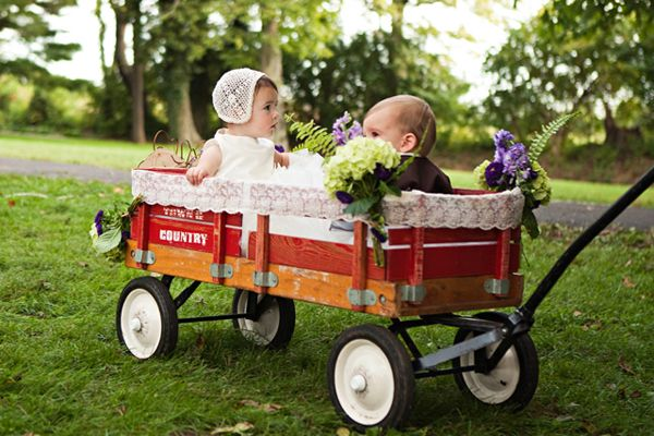 Take your flower girl and ring bearer for a ride in a decorated wagon.Photo Credit: Honey Heart Photography