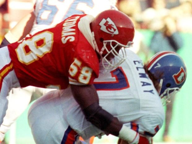 Kansas City Chiefs linebacker Derrick Thomas (58) sacking Denver Broncos quarterback John Elway (7) at Arrowhead Stadium on Nov. 12, 1989.