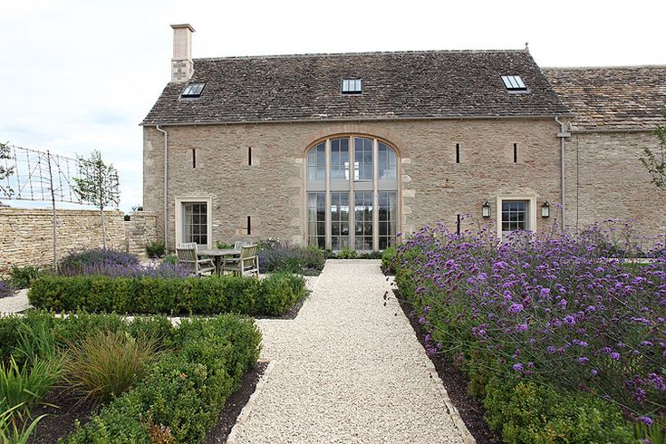 Cotswold Barn | Light Locations. Love the windows and beautiful garden beds, sigh!