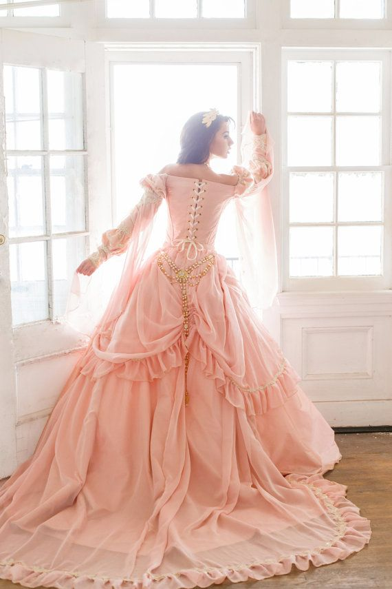 PRINCESS FANTASY CUSTOM GOWN  New color options for the Sleeping Beauty medieval fantasy gown. Shown in dusty rose with all champagne beaded laces and trims and chiffon drop sleeve. Train length is customizable, can be shorter. drop sleeves are optional as well. we have a chiffon trimmed matching cape available and jewelry available, these can be added for extra.  Please look up Sleeping Beauty gowns in our etsy shop to see other colors. Cape not included in this listing, but we all include…