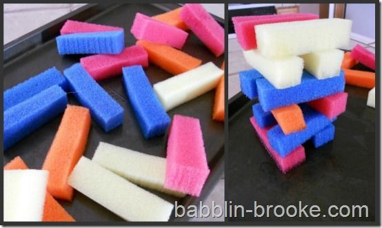 C and B have already had a ton of fun with this one!  Just cut some sponges into strips.  It doesn't get any easier than that, right?  My kids play with them slightly wet to help them stay.  Plus, C likes to squeeze the water out of them (over the cookie sheet, of course ;) ).  This keeps my kids entertained for quite a while sometimes.  And sometimes not, you know how kids are…