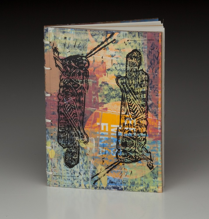 Cartonera inspired bindings. Ink over cardboad boxes with relief prints.