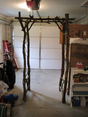 Simple wedding arch made with branches. Looks pretty simple and sturdy. Would make it as big as I could that's still transportable and dress it up with fabric.