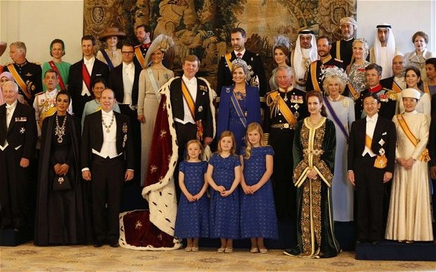 King Willem-Alexander of the Netherlands (C, L) and his wife Queen Maxima (C, R) pose for a photo with members of the royal household, heads of state and government and special guests at the Royal Palace in Amsterdam.