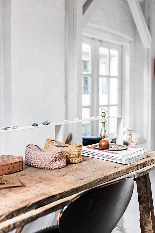 rustic wood desk in copenhagen home with white walls / sfgirlbybay