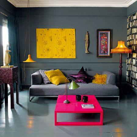 Super bright neon furniture and accessories against dark grey walls.