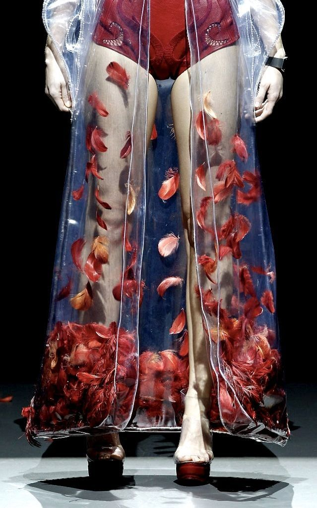 Reminiscent of the corsets alexander mcqueen had someone make-plexiglass with live worms -amd one with what looked like blood. Also 1970's cruel fish platforms...Leandro Cano FW 2014
