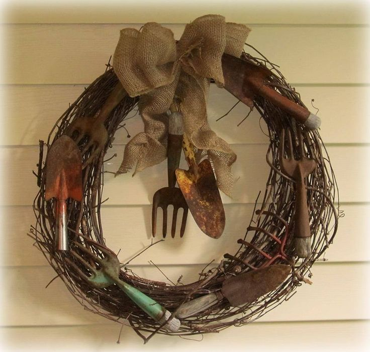 """Old Tool Wreath - Flea Market Gardening FB:  that Kirk & Carol Willis created! Kirk says, """"A tool wreath I made with an old grapevine wreath I had and some rusty, old, garden, hands tools. I love old tools! They have stories to tell. My wife Carol made the bow for the wreath with burlap ribbon. I think the bow """"makes"""" the wreath. I wired the tools to the wreath with a brown wire. A fun, simple, summer project."""