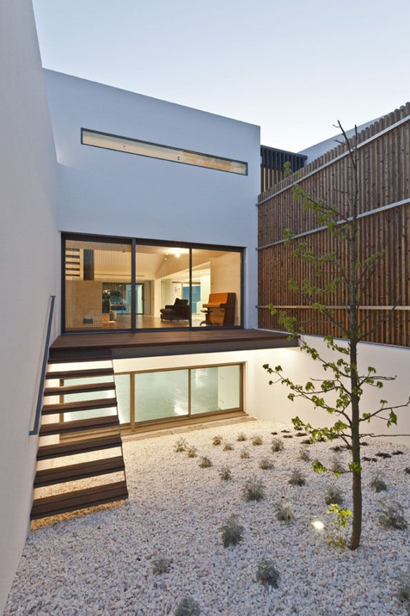 inclined court to let light enter to basement floor House In Vale Bem, Portugal by Espaço a3