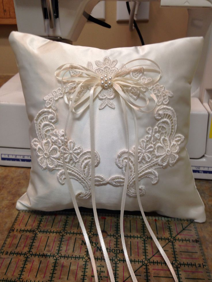 Ring bearer pillow for my daughter Bethany sewn with satin, lace and pearls from my wedding dress
