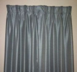 After searching everywhere for just the right pinch-pleated drapery for our new bedroom I gave up and made my own -- well, sort of. It was far...