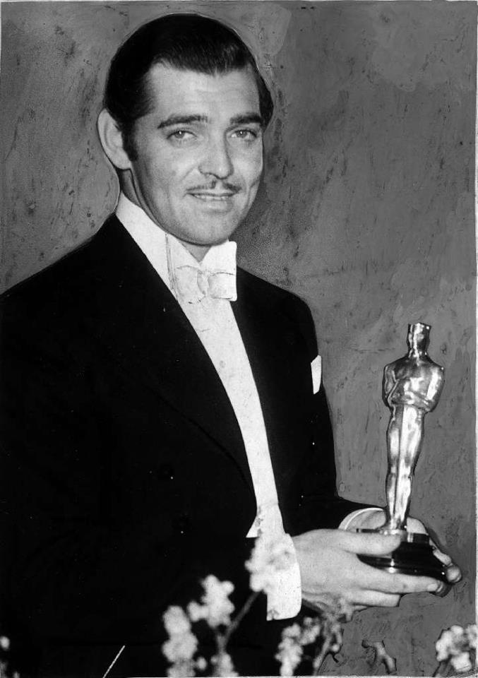 "Clark Gable poses with his best actor Oscar for ""It Happened One Night"" at the Oscar ceremony on Feb. 27, 1935"