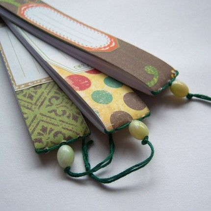 Looks like a bookmark notebook... Google Bilder-resultat for http://images.etsy.com/all_images/9/90a/ef5/il_fullxfull.14105391.jpg