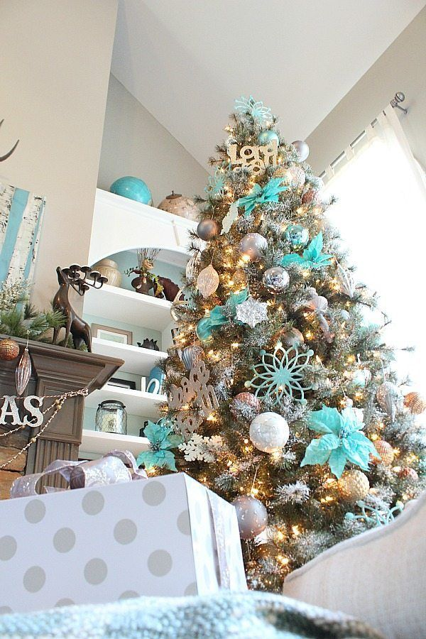 Copper, silver and grays really make the turquoise pop on this snowy Christmas Tree!