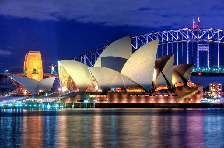 Sydney Opera House and Harbour Bridge in the background.