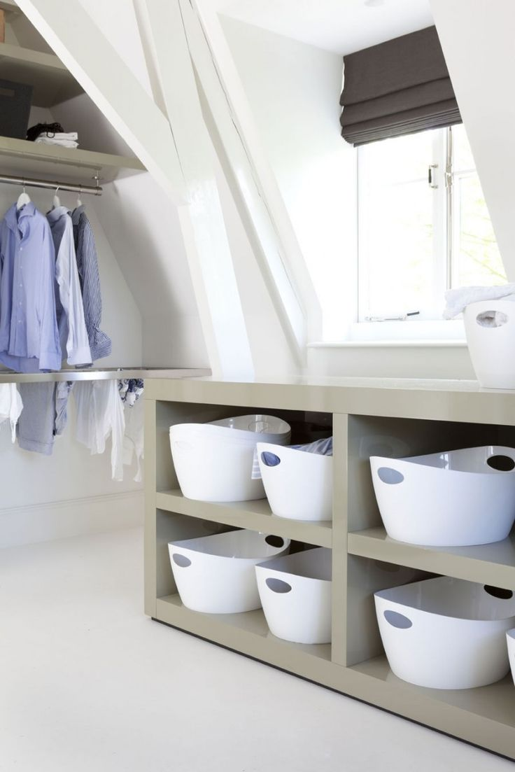 Manor by the River by Remy Meijers.  Modern laundry room.  Love the baskets