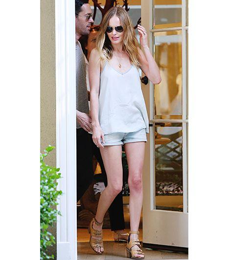 Kate Bosworth: silver shorts and top. Get The Look: Sam & Lavi Nicolas Tank ($115); Mavi Jeans Tiara Cuffed Mini Short ($47); Dolce Vita Studded Sandals ($125).