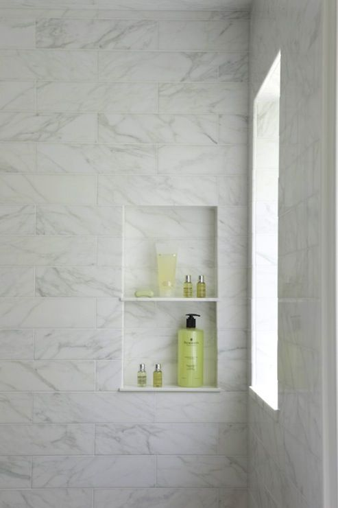 marble tiled shower with window and shelf