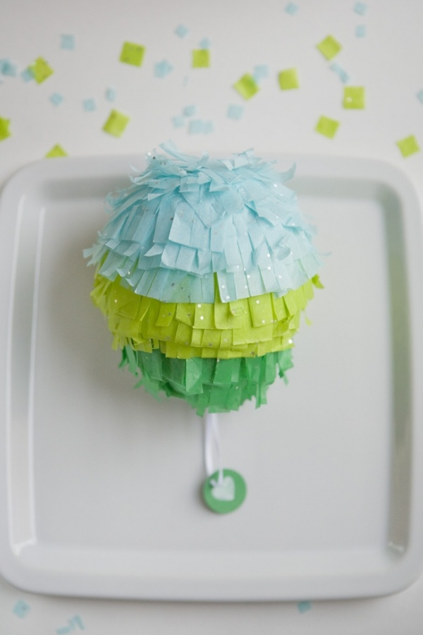 DIY mini pinata favors!  If you put these on wooden rock candy sticks, they'd make perfect baby rattles.