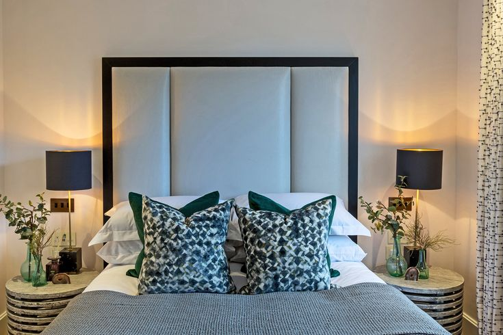 These sumptuously soft velvet Black Edition Oxide fabric cushions are rich in a vivid geometric pattern, perfectly mirroring the Valetta Cinder bee honeycomb curtain fabric by Villanova.