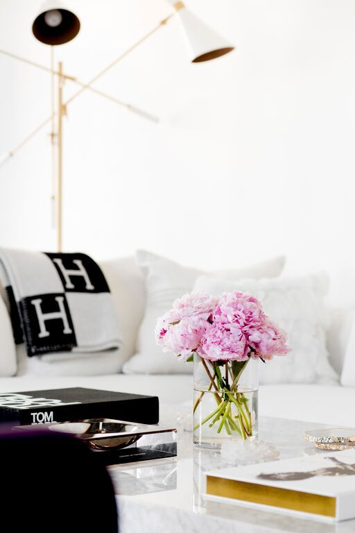 HouseTour:OneFifthAvenue - Design Chic - love the lamp in the living room and the flowers are amazing- peonies are a favorite!