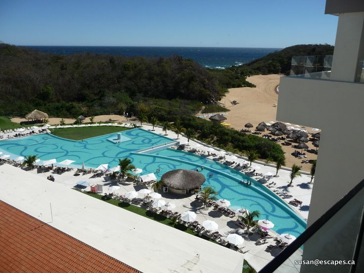 Secrets Huatulco, view to one of the pools and beach