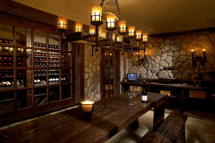 Love the stone and old timber soft yellow lighting wine for Home wine room lighting effect