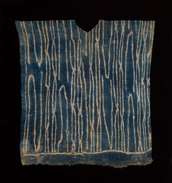 Africa | Ndop Tunic. Bamun or Bamileke People, Cameroon | Early 20th century| Strip woven indigo dyed cotton, resist technique ~ This is a very rare and early example of a Wukari style tunic.