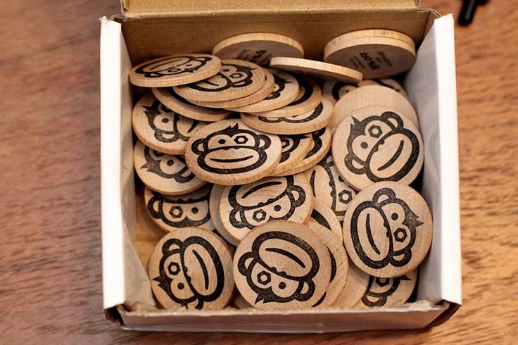 We sat down and hand stamped a box full of wooden tokens yesterday for our wonderful customers. We also tried branding these with a hot iron, but the thin wood warped under the heat. The monkey stamp...