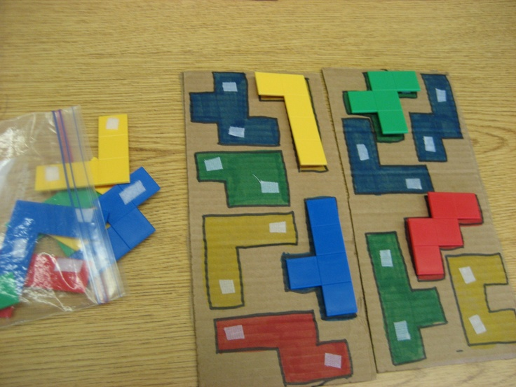 super cheap puzzle! Trace pieces on cardboard and color in. Add velcro and it's ready to go!
