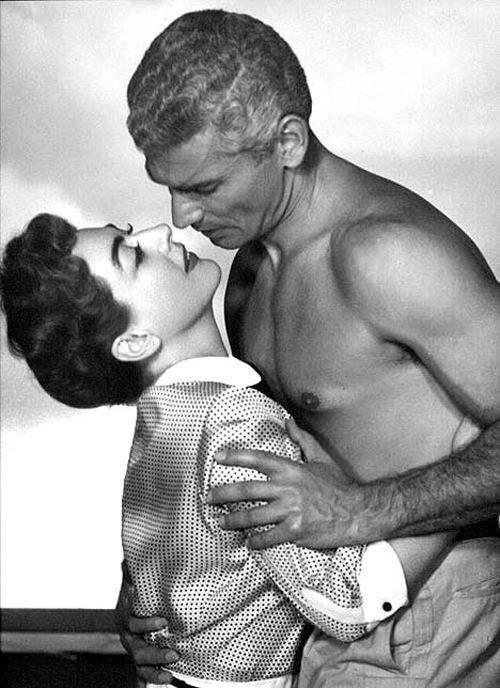 Joan Crawford being man-handled by Jeff Chandler,...