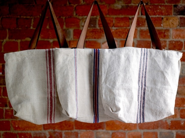 A Thoughtful Spot – Tote bags. Made from antique French linen grain sacks and reclaimed leather. Designed and handmade in Melbourne. • Available at thebigdesignmarket.com