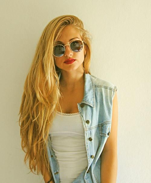 Sunglasses. Blonde. Denim vest. Red lips.