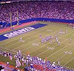 NY Giants. Giants Stadium was a multi-purpose stadium, located in East Rutherford, New Jersey, USA, in the Meadowlands Sports Complex. Maximum seating capacity was 80,242.[3] The building itself was 756 feet (230 m) long, 592 feet (180 m) wide and 144 feet (44 m) high from service level to the top of the seating bowl and 178 feet (54 m) high to the top of the south tower respectively.