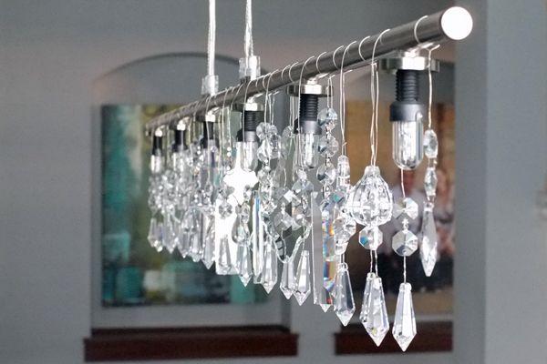credit: Teal and Lime [http://www.tealandlime.com/2011/10/diy-linear-crystal-chandelier/]