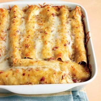 Lighter Chicken Enchiladas = Martha Stewart's most popular recipe of all time...yum minus the flour