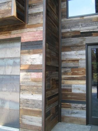 Reclaimed wood siding,  I really like the look of this for exterior finishes. Gotta figure it will last awhile,  likely lasted over a hundred years the first time around.